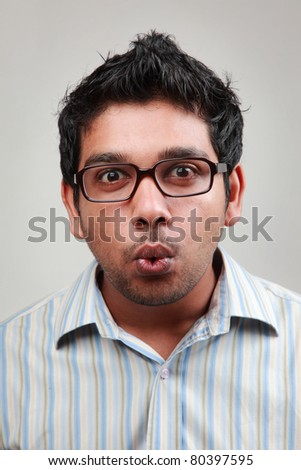 Man wearing spectacle shows a wow expression - stock photo