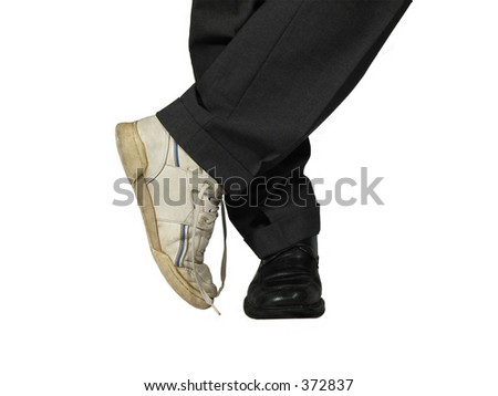 Man wearing suit and sport and elegant shoes - stock photo