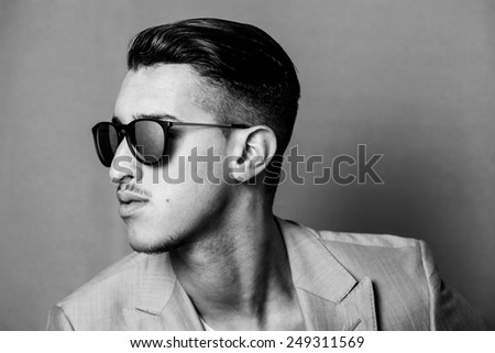 Man wearing sunglasses profile black and white - stock photo