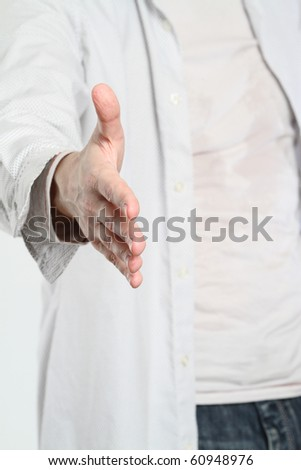Man wearing to white shirt ready for handshake.