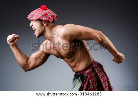 Man wearing traditional scottish clothing - stock photo