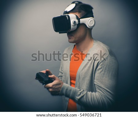 Man wearing virtual reality goggles. Play video games