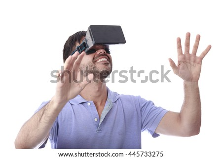 Man wearing virtual reality goggles. Studio shot, white background