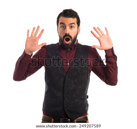 Man wearing waistcoat doing surprise gesture  - stock photo