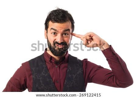 Man wearing waistcoat making crazy gesture - stock photo