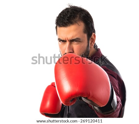 Man wearing waistcoat with boxing gloves