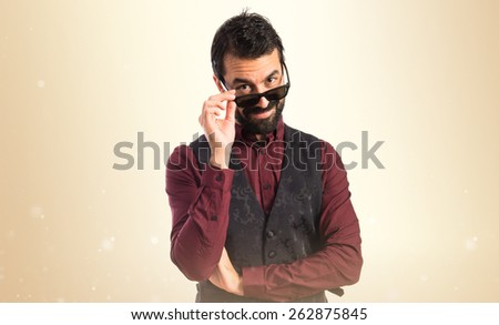 Man wearing waistcoat with sunglasses