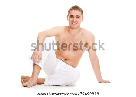 man wearing white pants sitting on the floor