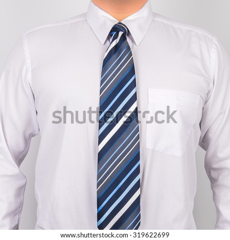 man wearing white shirt and striped tie - stock photo
