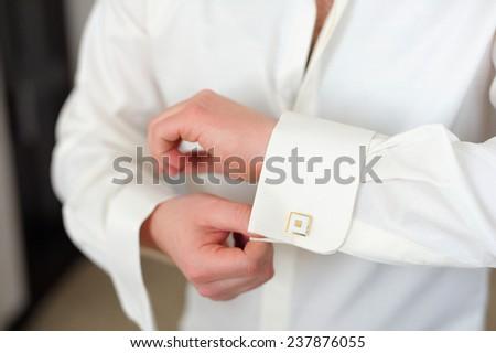 man wears white shirt and cufflink - stock photo