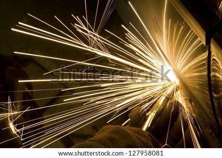 Man welding a car - stock photo