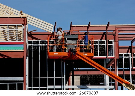 man welding a steel beam on new construction - stock photo