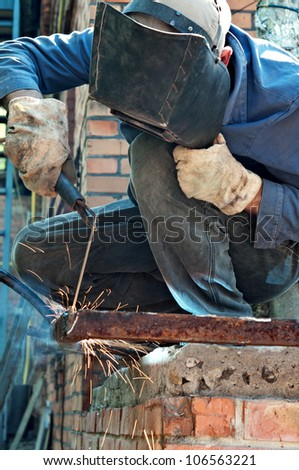 man welding in workshop with safety precaution - stock photo