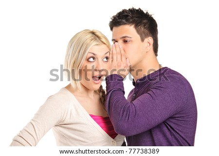 Man whispering a secret to a surprised young woman isolated on white background - stock photo