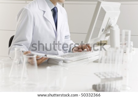 Man who experiments in laboratory - stock photo