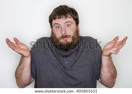 Man who is shrugging due to being confused about a question - stock photo