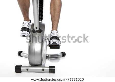 man who pedal stationary bikes - stock photo