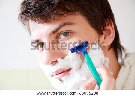 man who shaves - stock photo