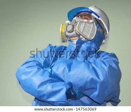 Man who working on acid mask - stock photo