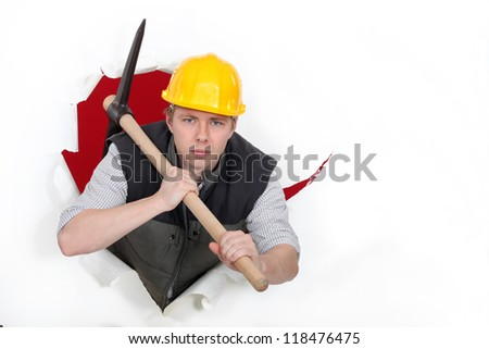 Man wielding pick-Axe - stock photo