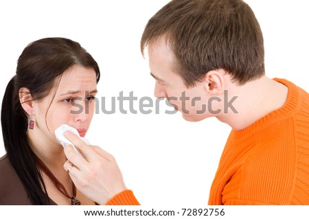 man wipes a tear from a woman with a handkerchief - stock photo