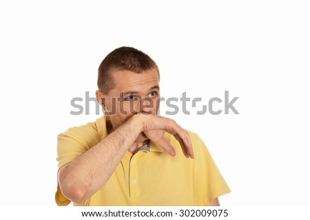 Man wiping snot by his hand on a white background - stock photo