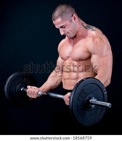 Man with a bar weights in hands training - stock photo