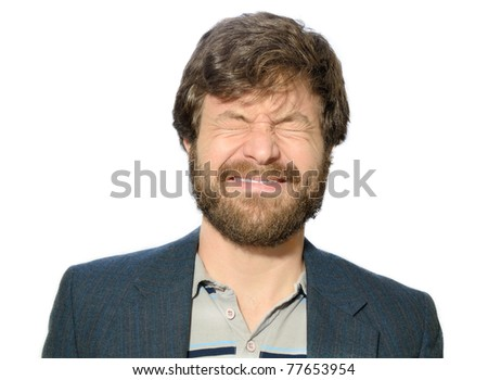man with a beard squinting