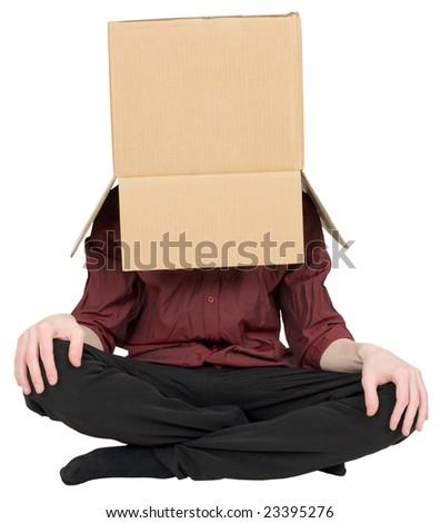 Man with a carton box on a head - stock photo
