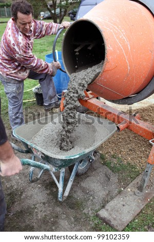 Man with a cement mixer - stock photo