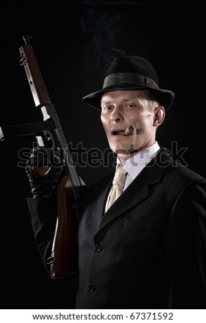 Man with a cigar  like a chicago gangster with submachine gun - stock photo