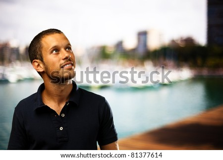 man with a city as a background - stock photo
