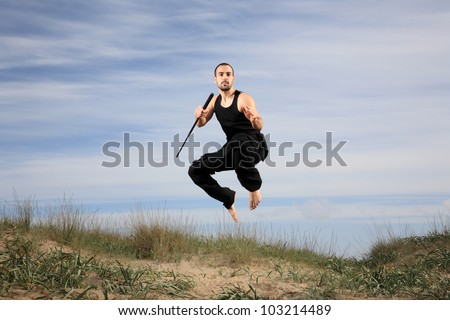 man with a crowbar in the air - stock photo