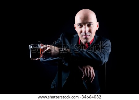 Man with a cup of tea or coffee on a black background