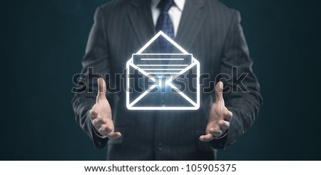man with a envelope on his hands - stock photo
