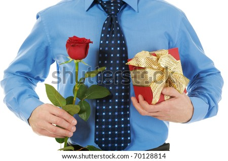 man with a gift box and a rose. Isolated on white background - stock ...