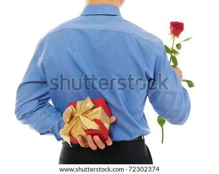 man with a gift box and a rose. Isolated on white background