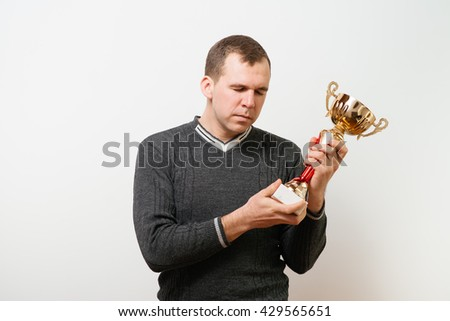 man with a golden cup