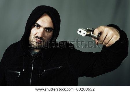 man with a gun and special photographic processing - stock photo