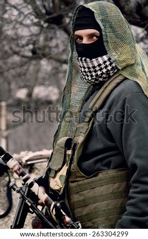 Man with a gun in hand - stock photo