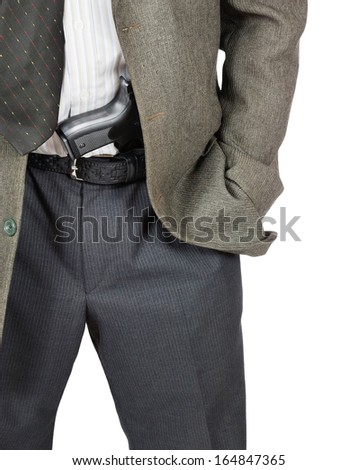 Man with a gun in his belt - stock photo