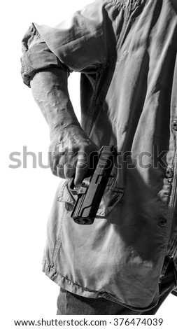 Man with a gun in his hand isolated on white background, black and white photo - stock photo