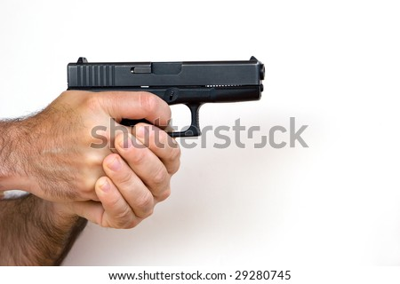 Man with a Gun in His Hands - stock photo