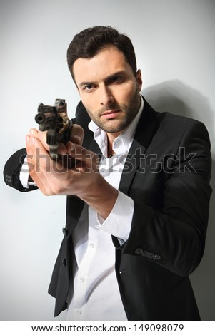 Man with a gun, isolated  - stock photo
