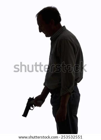 Man with a gun, on white background - stock photo