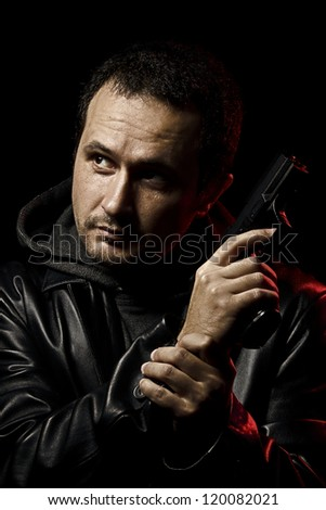 man with a gun ready to shoot