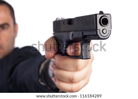 man with a gun ready to shoot (focus on the weapon)