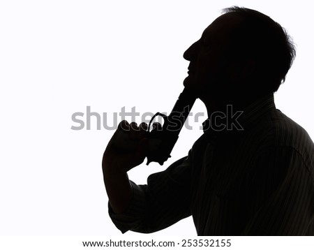 Man with a gun, Trying to commit suicide, on white background