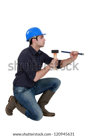 Man with a hammer and chisel - stock photo
