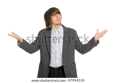 Man with a kind of uncomprehending opened his arms to the sides. - stock photo